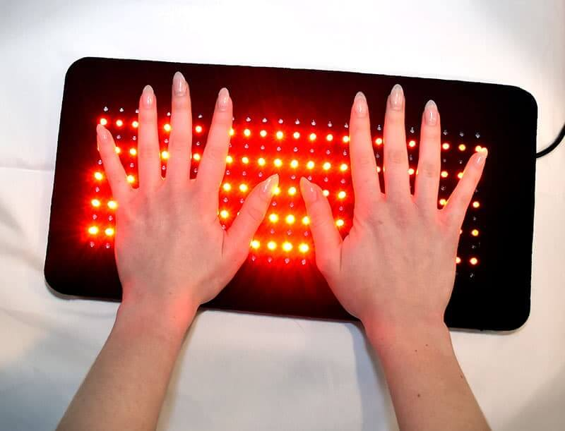 264 Red Light Therapy Pad on the Hands